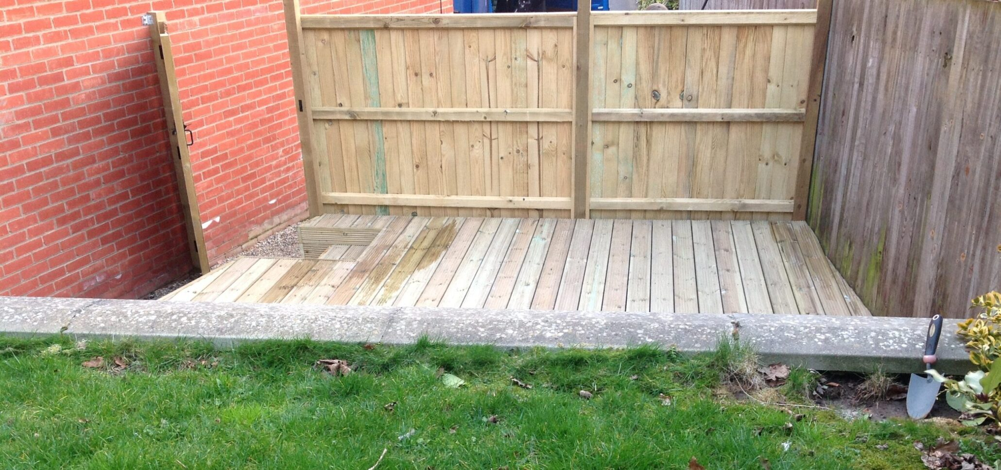 Fencing norwich norwich decking co decking installed behind fence panels with a gate for privacy baanklon Choice Image